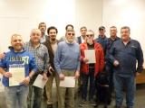 Grupo de 11 personas que participaron en la entrega de diplomas, incluyendo a los docentes